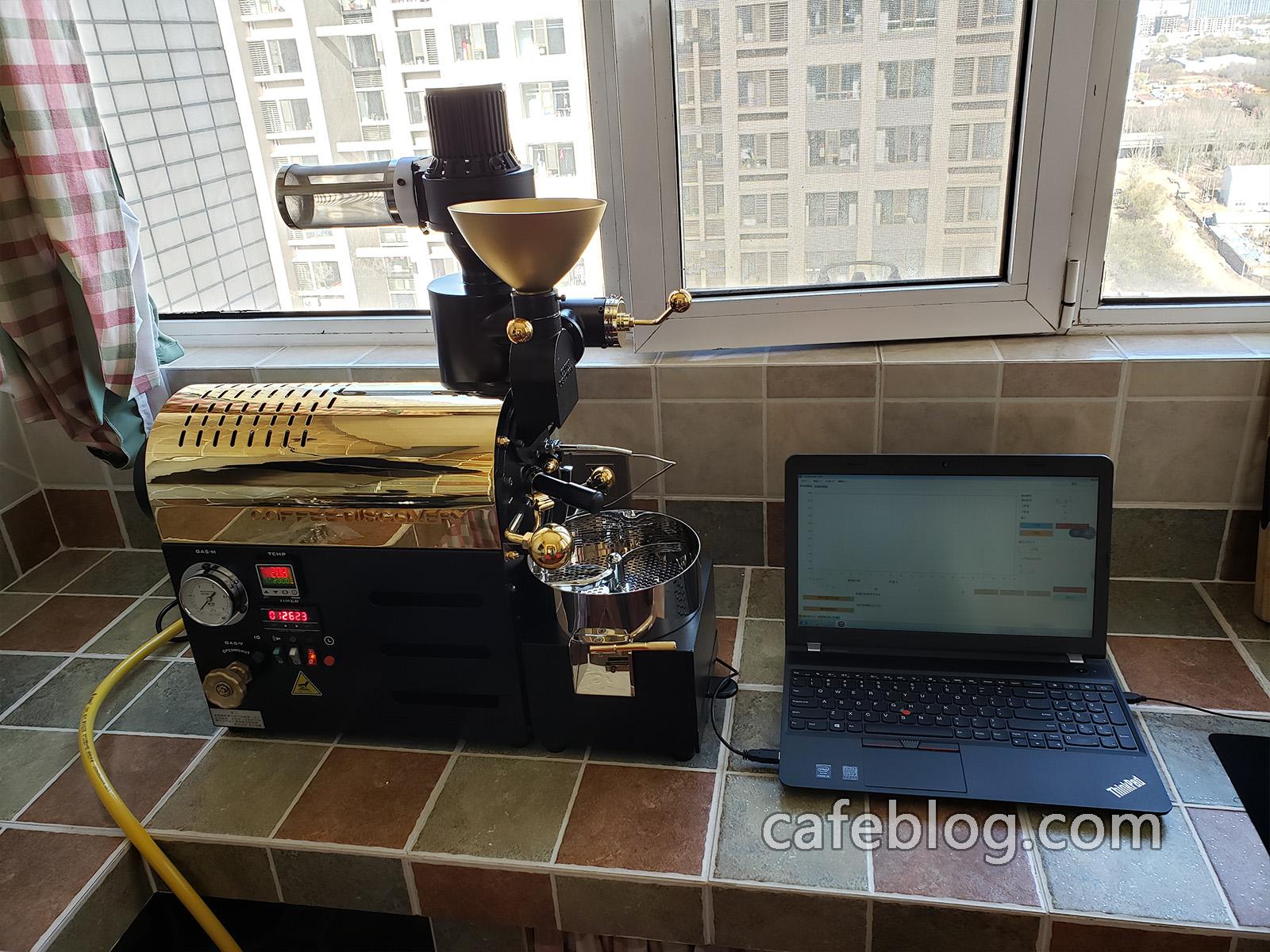 是一台电脑板DISCOVERY咖啡烘焙机。